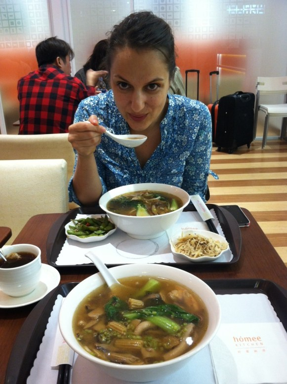 Enjoying a delicious noodle soup from homee Kitchen in Taichung Airport