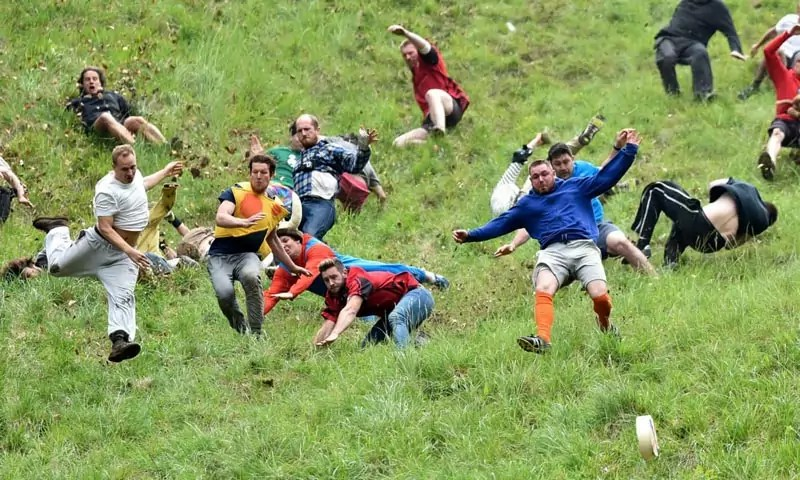 Cheese Rolling Festival - Weird Things to do in Europe