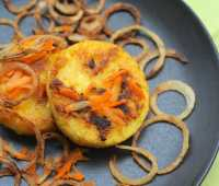 pantry polenta cakes with carrot, cheese and crispy onions