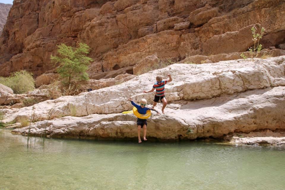 Oman with kids. Jumping into Wadi Shab.