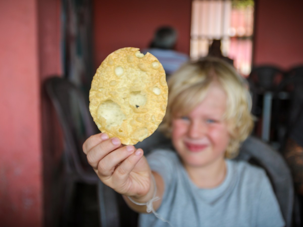 Harry trying chapati. His favourite of all the Indian breads tried.