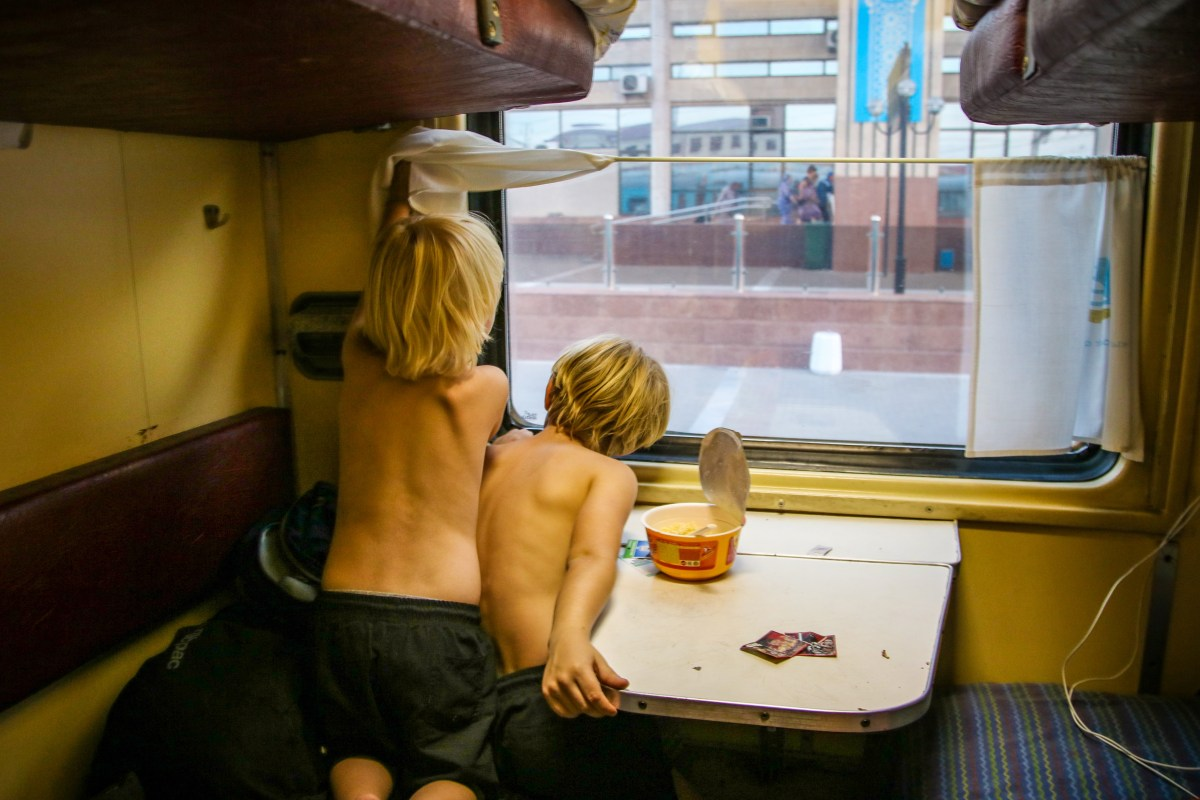 Inside our cabin on board the train to Nukus. Traveling by train in Uzbekistan with kids.
