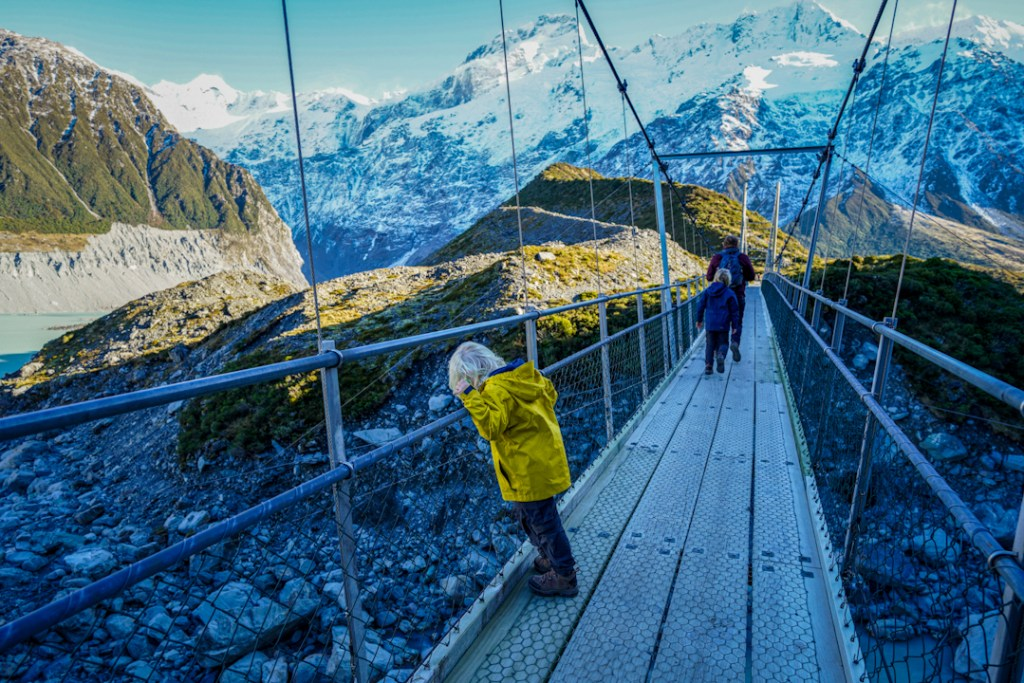 On the suspension bridge walking the Hooker Valley track with kids.