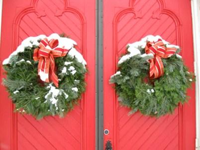 Beautiful Christmas wreaths decorating a church's doors.