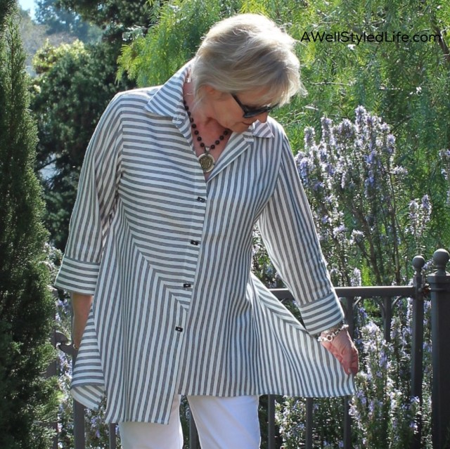 The high-low hem and unusual cut of this shirt make it slimming and unique.