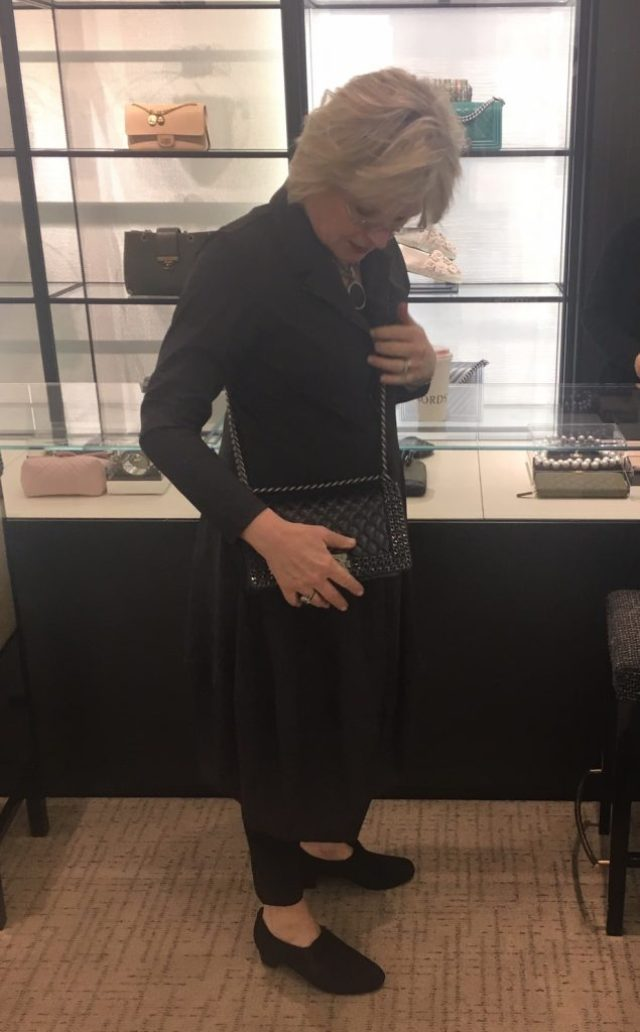 Trying on a Chanel handbag for size