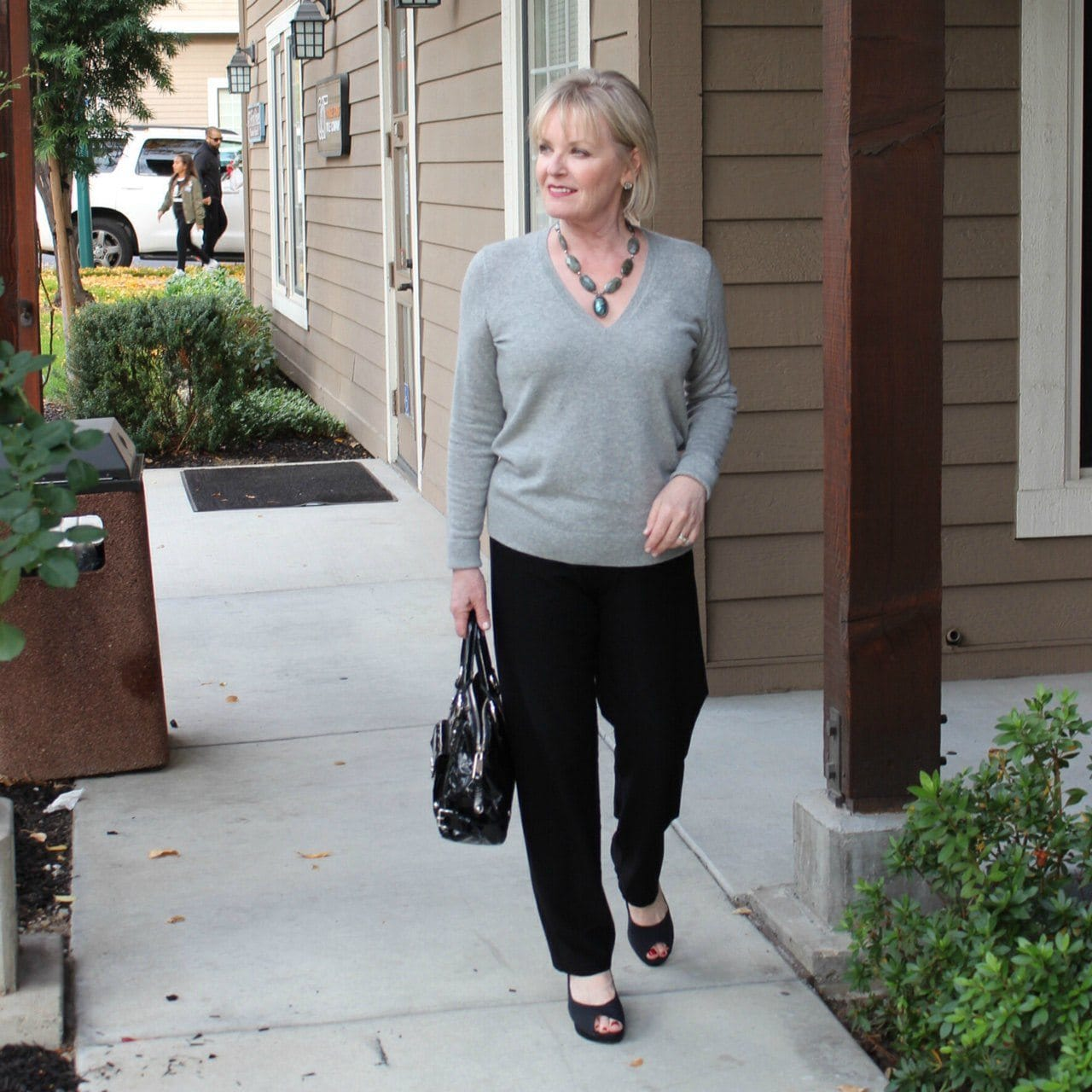 Jennifer Connolly of A Well Styled Life wearing Eileen Fisher Crepe knit pants