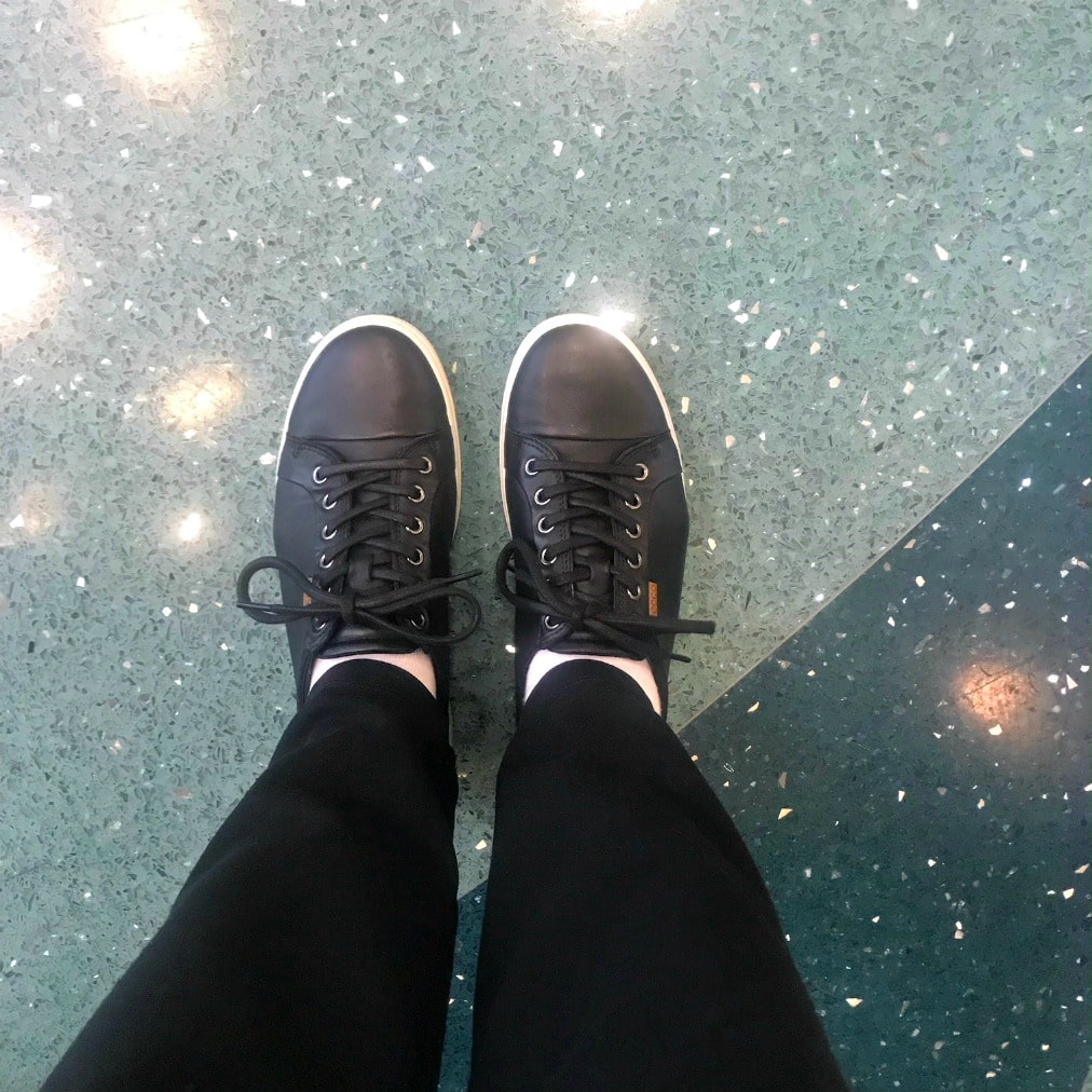 Jennifer Connolly of A Well Styled Life wearing ECCO sneakers to travel