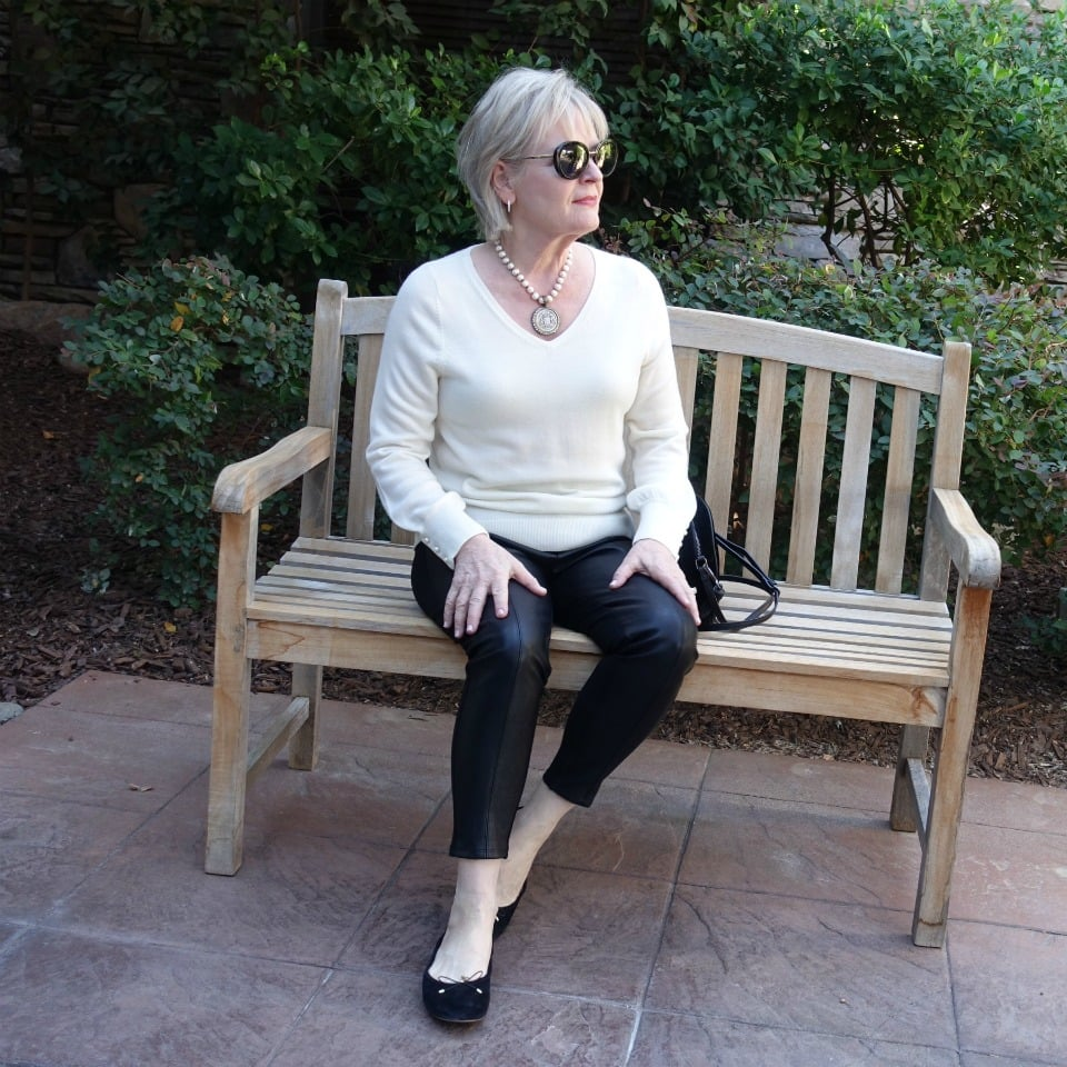 Jennifer Connolly of A Well Styled Life wearing faux leather leggings from Ann Taylor