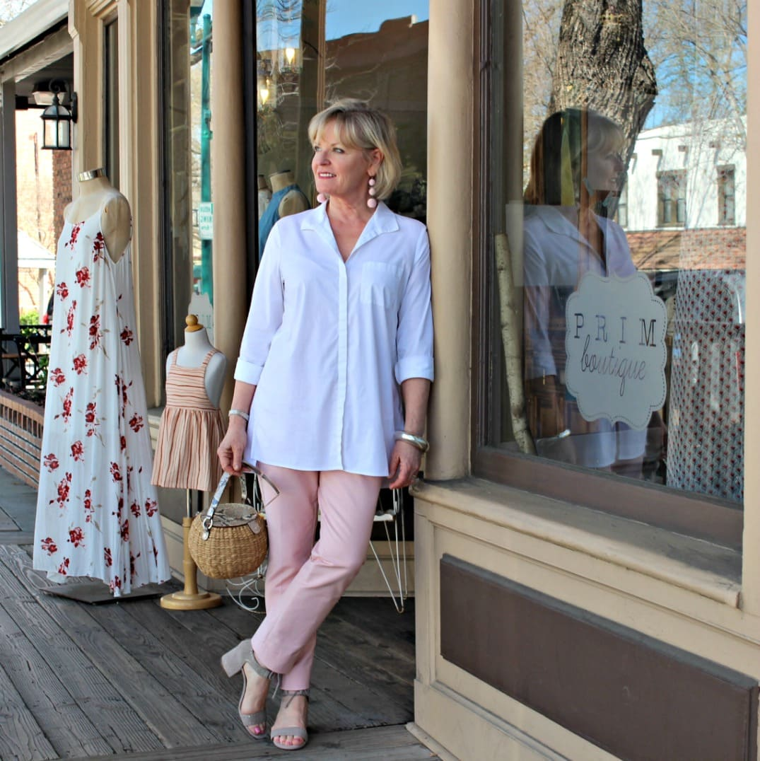 Jennifer of A Well Styled Life wearing pink pants with white shirt and taupe sandals