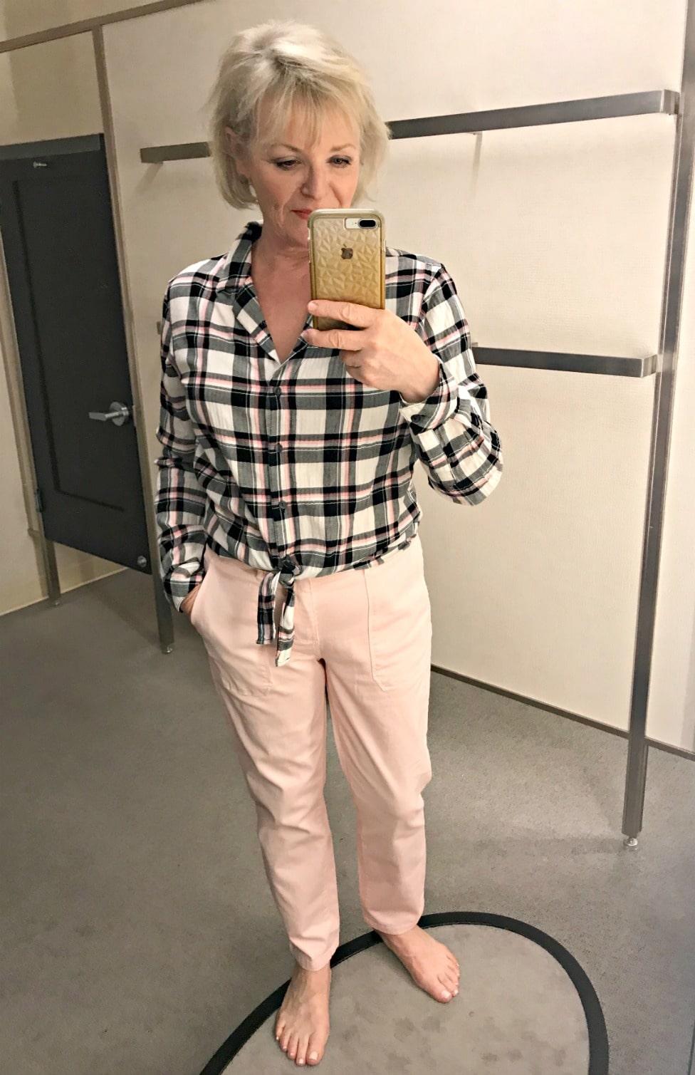 Jennifer Connolly wearing plaid shirt and pink pants