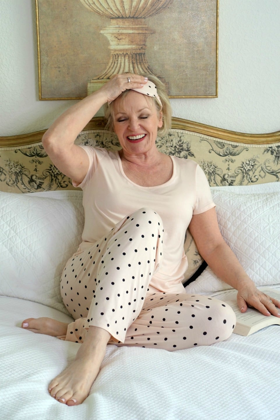 Jennifer Connolly of A Well Styled life wearing Soma pajamas and sleep mask in peach polka dot