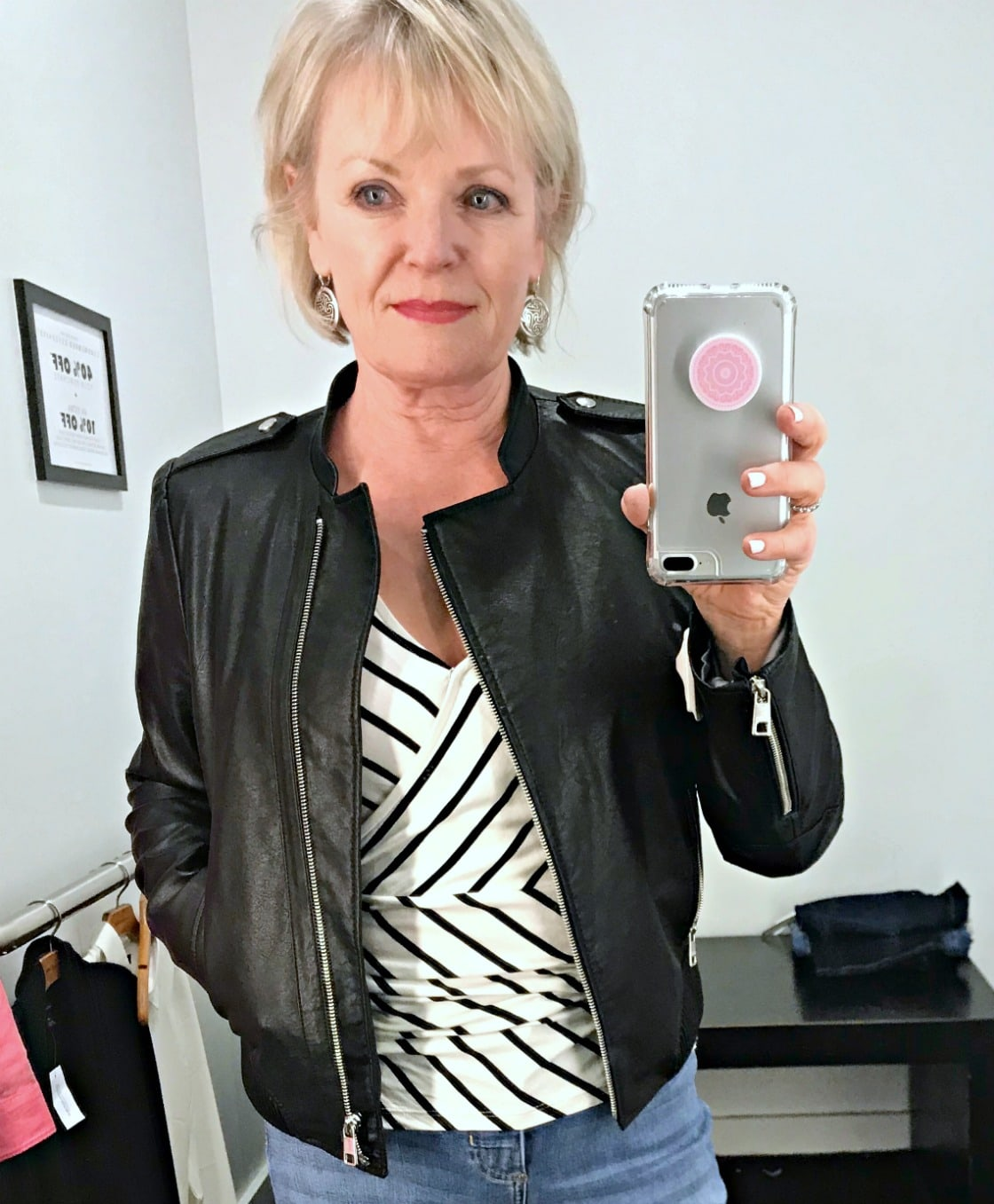 Jennifer Connolly of A Well Styled Life wearing black moto jacket and striped top from Banana Republic