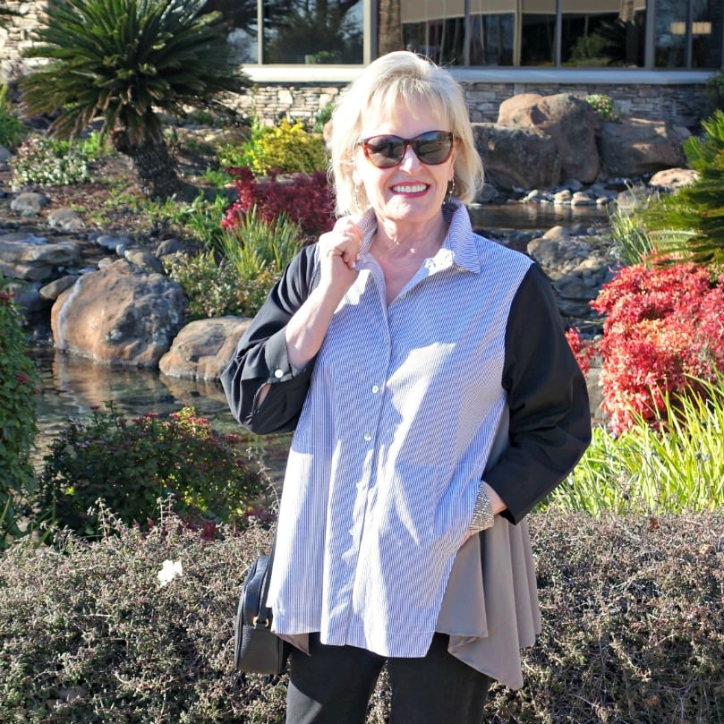 Jennifer of A Well Styled life wearing black and white shirt and black jeans from Artful Home