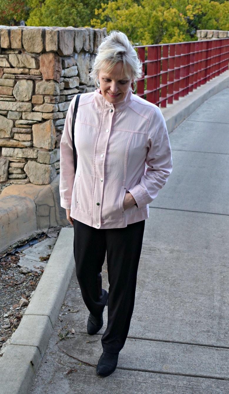 Jennifer of A Well Styled Life wearing C&B pink jacket, black pants