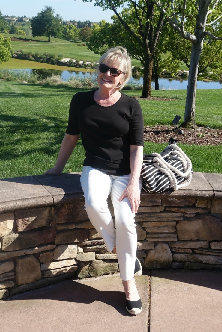 Jennifer from A Well Styled Life wearing casual tee and jeans from Walmart