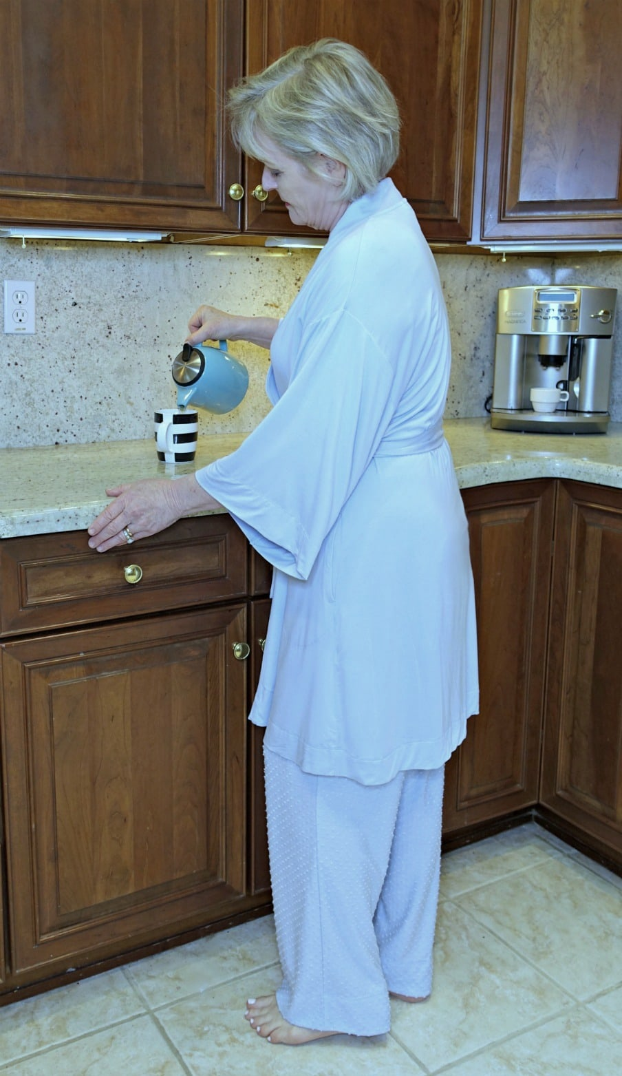 Jennifer of A Well Styled Life pouring tee in the morning wear rove and pajamas from Soma in cool blue color