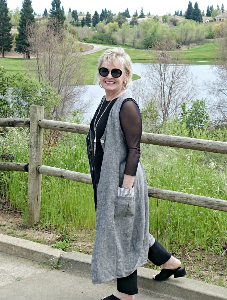 gray linen vest from Artful Home over black jeans and black tee