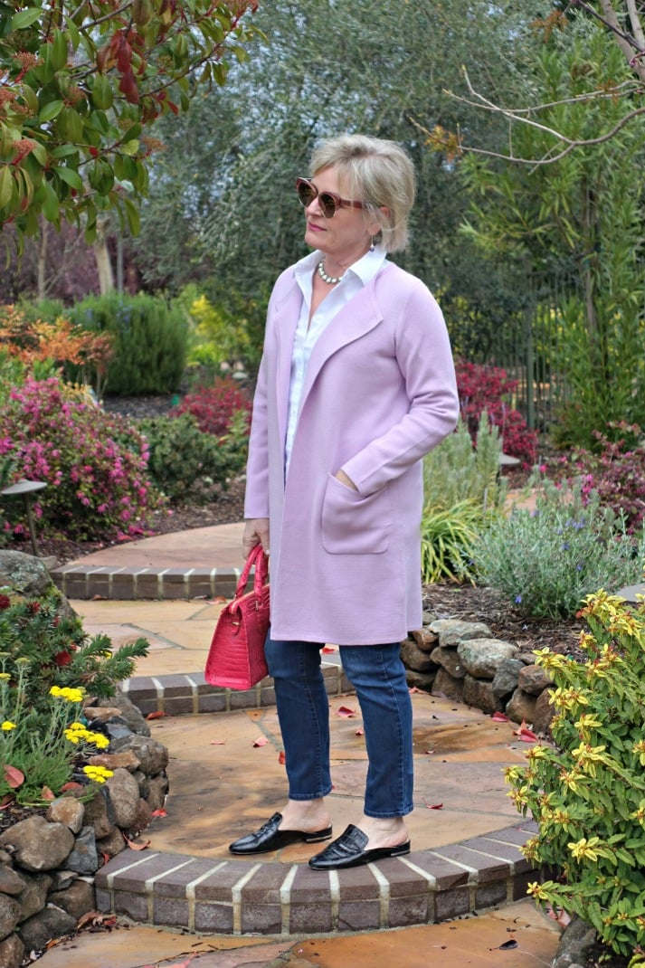 J.Crew sweater blazer in Wysteria over blue jeans and white blouse on Jennifer Connolly in park setting