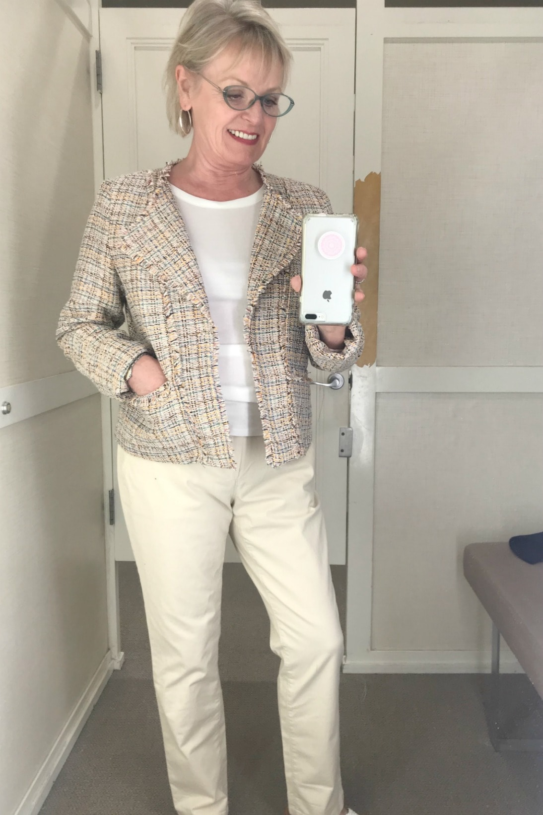 Jennifer of A Well Styled Life wearing beige tweed jacket and beige chino's from Loft on A Well Styled Life