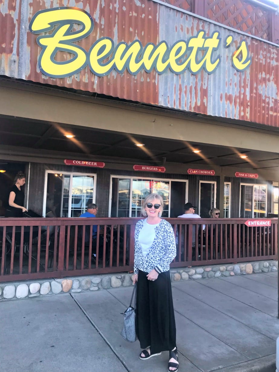 Jennifer Connolly of A Well Styled Life dressed for RV travel wearing leopard cardigan from Banana Republic with black knit pants a Eileen Fisher sport sandals