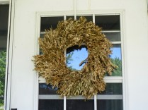 Spring Wreath 2016 - Dried boxwood decorated by a bird's nest barely visible at the top