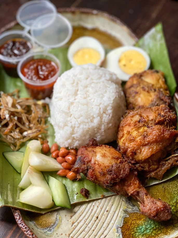 Nasi Lemak (₱450/set). comes with 2 fried chickens, 200g of Nasi Lemak, ikan bills, 2 homemade samba belachan (one version made with keluak), cucumbers, fried peanuts and a hard boiled egg.