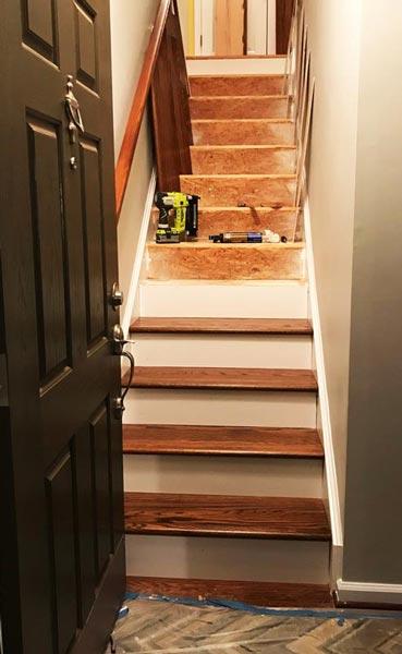 Dark walnut stained red oak stairs