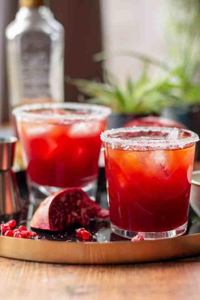Pomegranate Margarita with a salt rim and pomegranate seeds