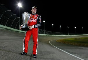 Tony Stewart on track with Championship Trophy.