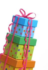 A stack of bright gift boxes perfectly isolated on a white background