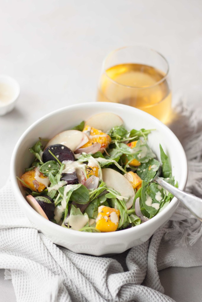 Warm Pumpkin Salad with Apple Cider Tahini Dressing
