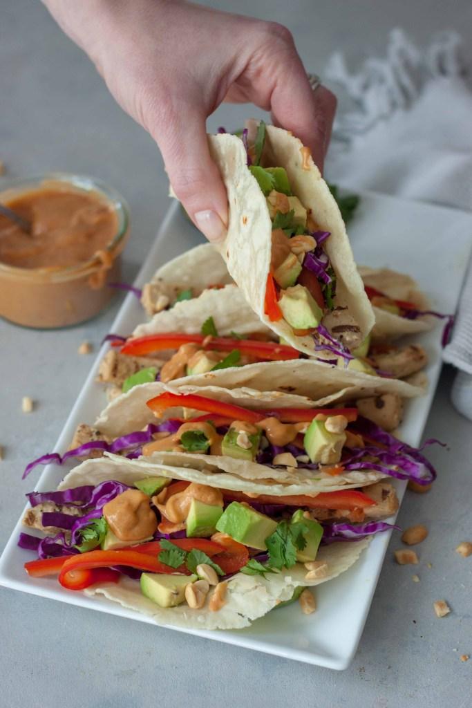 hand holding a Vegan Thai Taco
