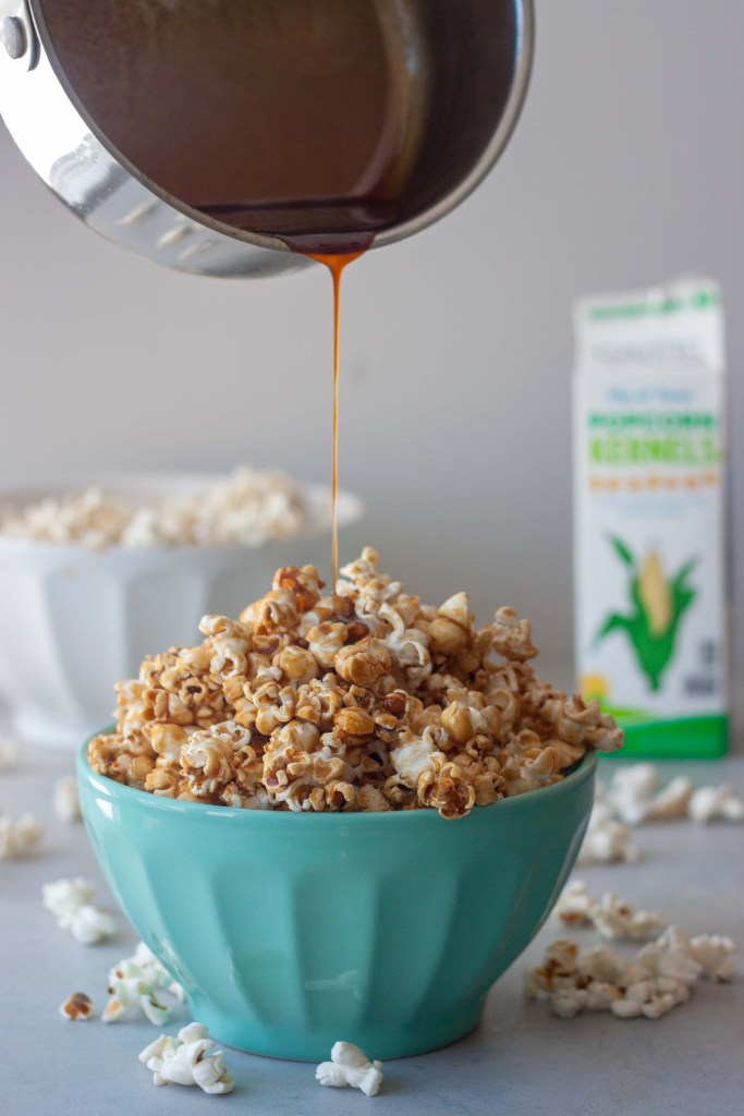 Drizzling caramel, bowl of Healthier Caramel Popcorn