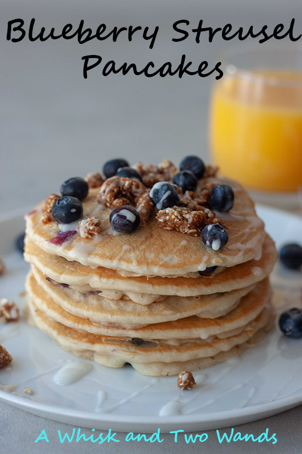 Blueberry Streusel Pancakes Fluffy stack of gluten free vegan friendly pancakes bursting with blueberries with a hint of everything you love from a blueberry streusel muffin including the crumble topping and icing. A stack is sure to sweeten up any morning!