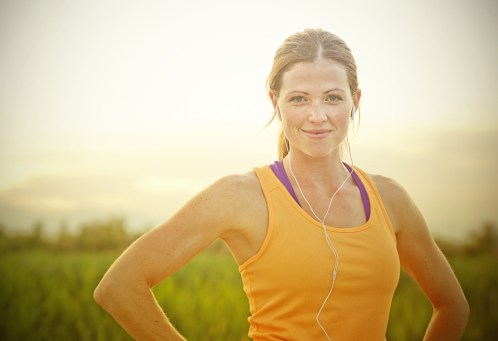 smiling woman jogging