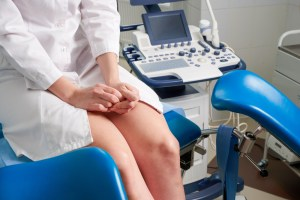Woman at gynecologist office sitting and waiting for a doctor