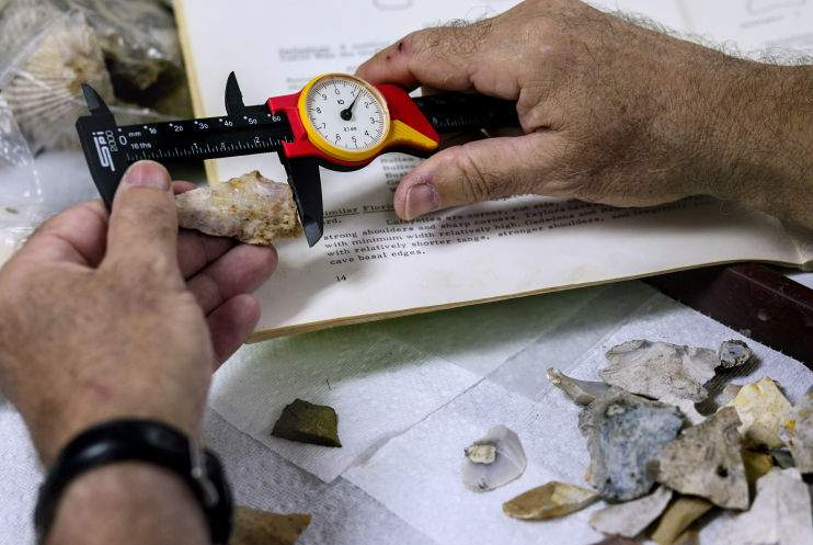 Bob Austin measures projectile points used as spears or knives.