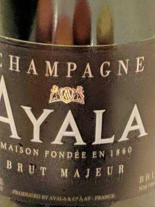 Ayaya Champagne with macaron desert
