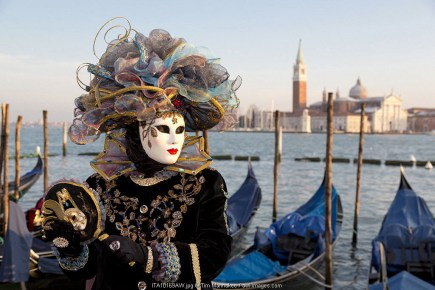 Beautiful costume and mask at the Venice Carnival, Piazza San Marco (St. Mark's Square), Venice, Veneto, Italy