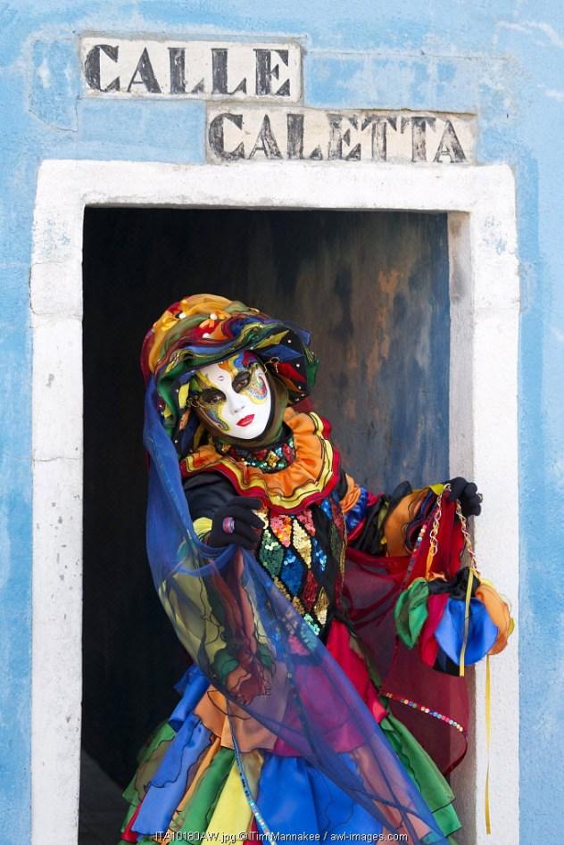 Colourful costume worn during the Venice Carnival on the island of Burano, Venice, Veneto, Italy