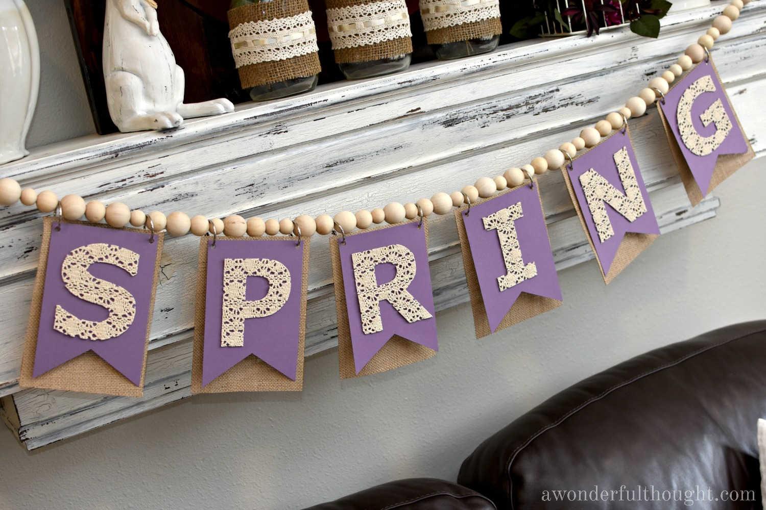 Beaded Cotton Lace Spring Banner | awonderfulthought.com. Make this wooden bead garland and add some lace letters for the perfect spring decoration!