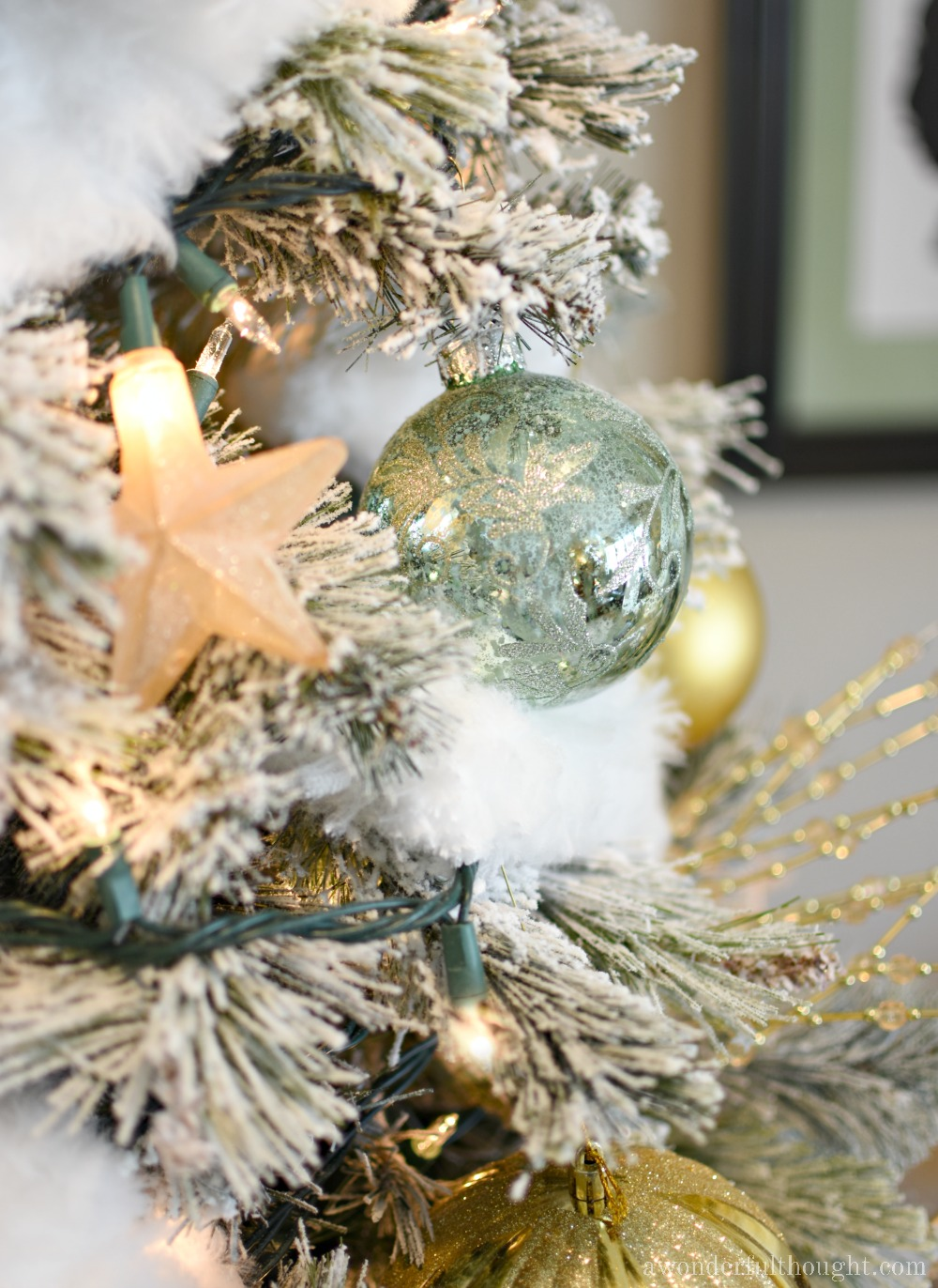 Silver, Gold and Light Green Snowy Christmas Tree #christmastree #christmastreeideas #flockedchristmastree #awonderfulthought