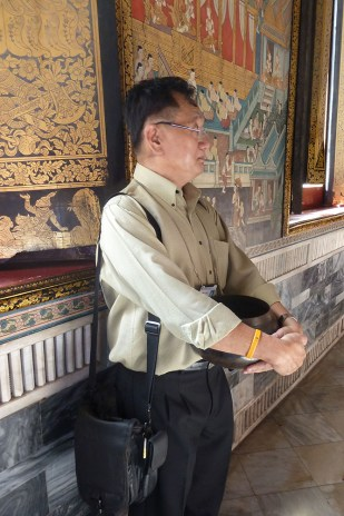 "Standing in the Wat Pho, Sarunsiri remembers his time as a monk, during which he sometimes had to carry a rather heavy cauldron in front of his belly, which he says made him ""understand pregnant women."""