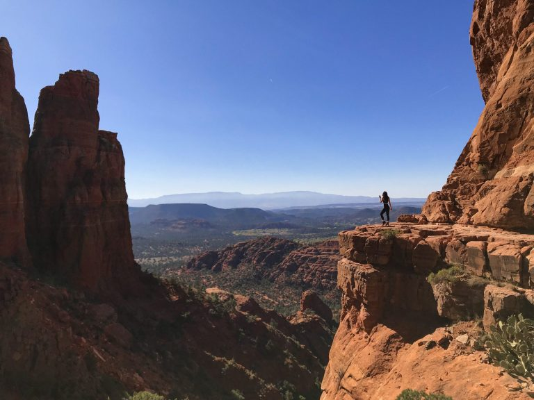 Silhouette of woman on Cathedral Rock in Sedona, Arizona