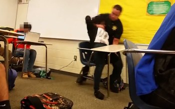 A cop body slams a teenage girl before dragging her across the classroom at Spring Valley High School in South Carolina, Oct. 2015.
