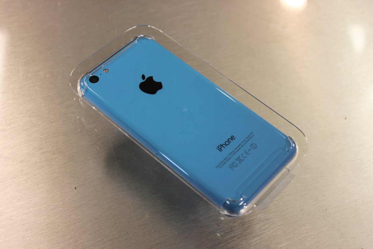 iPhone 5C Blue held into Plastic core