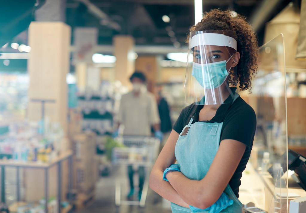 Retail worker wearing personal protective equipment (PPE)