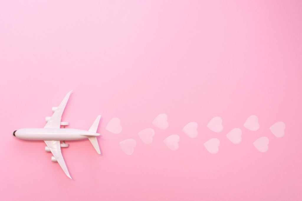 Flying plane on solid colour background