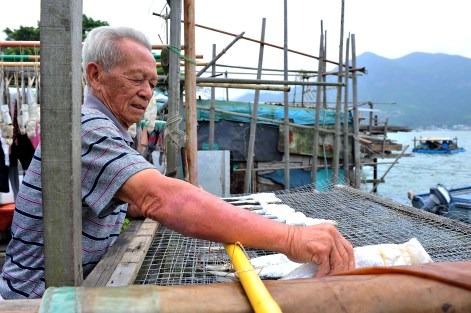 Ho Cho Tai, 80, has been living in Tai O since he was born. At the age of 70, he retired from his work as a fisherman and started making sun-dried salted fish as his leisure activity.